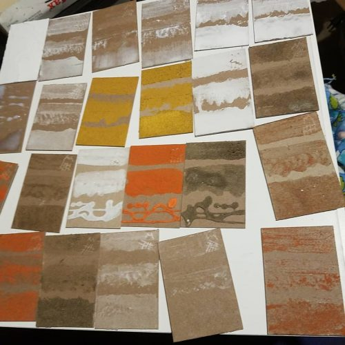uninked drying test plates with a variety  of mediums and sands