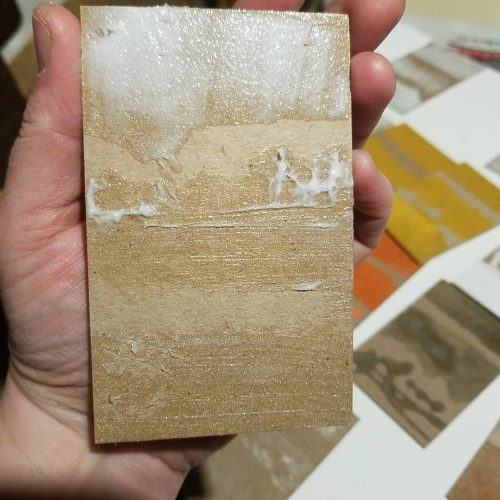 hand holding an uninked test plate