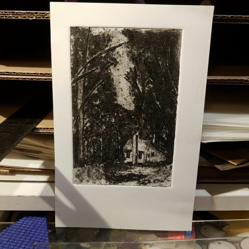 small print of a cabin in the woods, small cabin is overshadowed by large trees