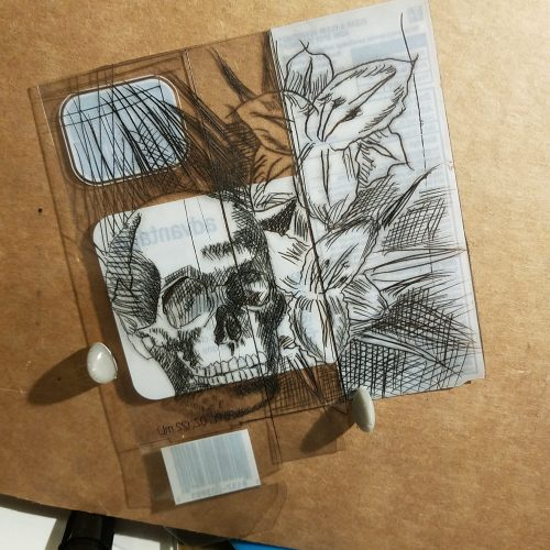 plastic package etched with skull and daylilies image