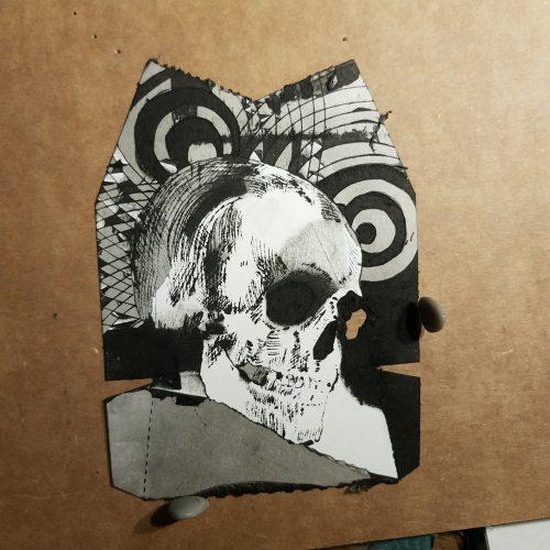 Skull etched into flatten hershey pie carton